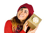 Brunette in hat listening a gift