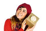 Brunette in hat listening a gift
