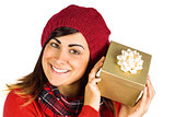 Pretty brunette in hat holding a gift