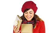 Happy brunette opening christmas gift