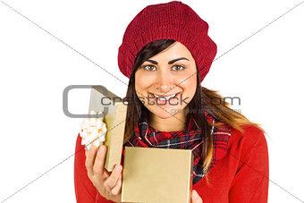 Smiling brunette opening christmas gift