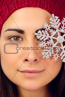 Close up of a brunette holding snowflake
