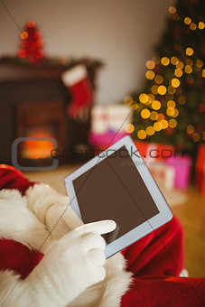Father christmas touching tablet pc