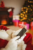 Santa claus using a smartphone at christmas