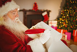 Santa claus writing his list on scroll