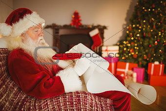 Santa claus writing his list on scroll