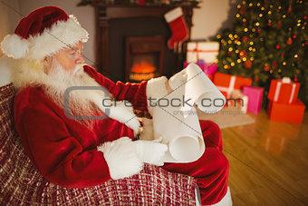 Santa claus reading his list at christmas