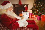 Father christmas holding piggy bank