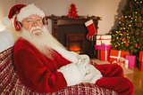 Smiling santa claus listening music