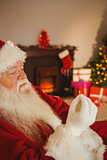 Father christmas holding engagement ring