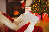 Santa claus writing list with a quill