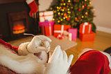 Santa claus holding his glasses