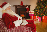 Santa claus sitting and holding his belly