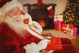 Smiling santa making a phone call