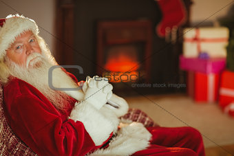 Santa claus relaxing on the couch
