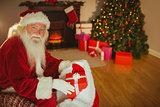 Cheerful santa claus stocking gifts