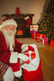 Smiling father christmas stocking presents