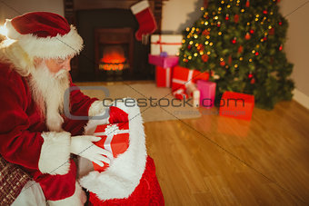 Santa claus stocking gifts at christmas