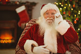 Smiling santa holding his glasses