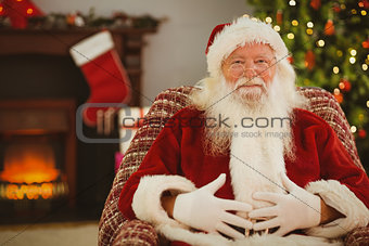 Portrait of santa holding his belly