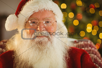 Portrait of smiling santa with his glasses