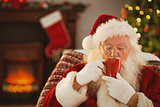 Father christmas drinking a hot beverage