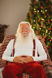 Smiling santa without his jacket relaxing