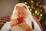 Father christmas drinking hot beverage