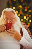 Father christmas drinking hot drink