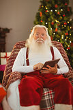 Happy santa using tablet pc