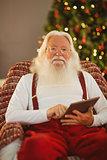Happy santa using digital tablet