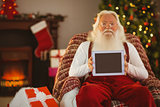 Santa claus showing tablets screen