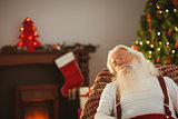 Father christmas resting on the armchair