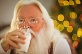 Santa claus drinking a glass of milk