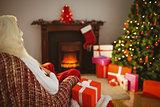 Santa claus sitting on the armchair