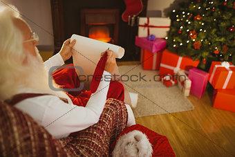 Santa claus holding his list