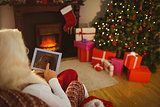 Santa claus touching digital tablet