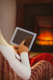 Father christmas touching digital tablet