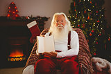 Santa claus showing his book