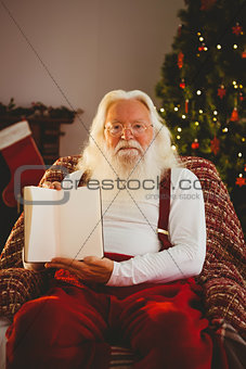 Portrait of santa showing his book