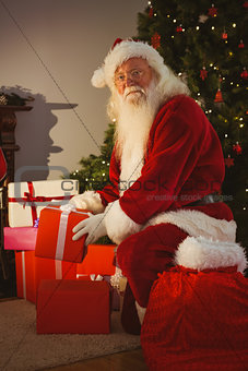 Portrait of santa delivering gifts at christmas eve