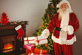 Joyful santa delivering gifts at christmas eve