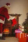 Father christmas stocking gifts at christmas eve