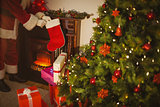 Father christmas stocking gifts at christmas eve