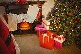 Santa claus holding a paper