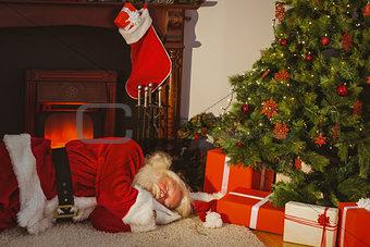 Santa claus napping on the rug