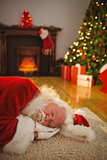 Santa claus napping on the rug