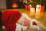 Father christmas sleeping on the rug