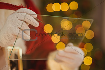 Close up of santa writing list on the glass