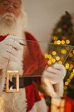Santa claus writing list on pane